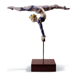 """Lladro Porcelain - Lladro Acrobat Over Bar Figurine - Plus One Year Accidental Breakage Replacement - """" Lladro pays tribute to the modern circus with a series of spectacular sculptures in which equilibrium, poise, elegance and agility have been rendered to perfection in each one of these pieces.  The excellent modeling work is truly spectacular and required thorough prior anatomical study.  The posture of the bodies, the tension of the musculature and the expression on their faces play a truly important role in making us see and understand the difficulty in performing these exercises.  The balancer is executing an exercise on the floor as she keeps a large umbrella spinning with almost imperceptible movements.  Worth noting is the decoration of her costume, adorned with gold luster to draw the fine intertwining lines. The circus and its bright coloring was ever present in the decoration of these pieces and various techniques are used : glaze and matte are combined, golden luster applied in some of the details of the artists costumes, as well as Lladros classic palette of colors, though in stronger tones than we are used to seeing in other pieces. Hand Made In Valencia Spain - Sculpted By: Ernest Massuet - Limited To: 3000 Pieces Worldwide - Included with this sculpture is replacement insurance against accidental breakage. The replacement insurance is valid for one year from the date of purchase and covers 100% of the cost to replace this sculpture (shipping not included). However once the sculpture retires or is no longer being made, the breakage coverage ends as the piece can no longer be replaced. """""""
