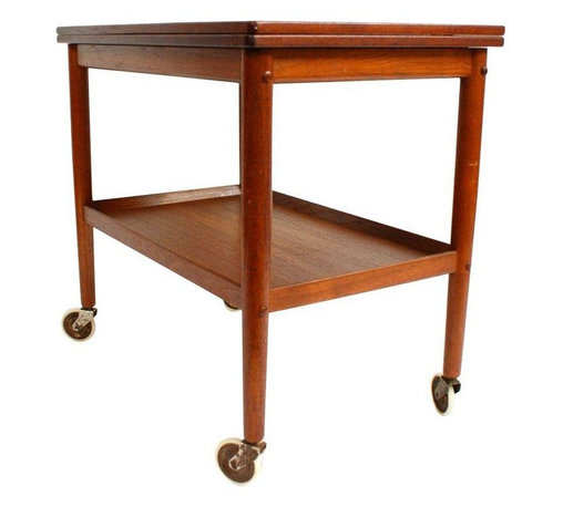 """Pre-owned Grete Jalk Danish Modern Teak Bar Serving Cart - Are you looking for the perfect Mid-Century bar cart for a small space? Well, you have Danish modern craftsmanship to thank for this understated yet functional convertible cart. Crafted of solid teak, with a hinged fold out table, it functions as a bar cart, serving cart, or extra space for your dining table. This piece is marked, """"Made in Denmark,"""" and was designed by Grete Jalk. The cart is in good condition with minor age appropriate wear including a nick on the underside edge of the bottom shelf.     Table open length: 36.5"""""""