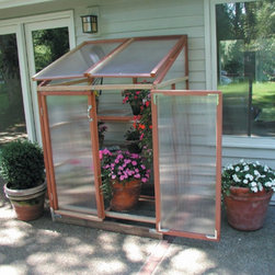 Sunshine - Sunshine 4 x 3-Foot Lean-To Patio Greenhouse - GKP-PGH - Shop for Greenhouses from Hayneedle.com! Additional FeaturesPeak height measures 72H inchesDoes not take long to assemble5-year warranty is includedThe perfect size for your patio or deck the Sunshine 4 x 3-Foot Lean-To Patio Greenhouse is well-built and easy-to-move. With its clear natural and sturdy redwood frame and twin wall polycarbonate panels which protect your plants this greenhouse may be small but it has all the benefits of a larger greenhouse. The Sunshine Patio Greenhouse also comes with four adjustable benches so you can grow a variety of different sized plants and have additional room. A five-year warranty is included.