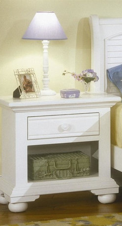 American Woodcrafters - Cottage Traditions Small Nightstand in Eggshe - This faithful bedroom bookend puts convenient storage & display options at your disposal. Bottom area has roomy open area for display, while roomy drawer keeps essential items hidden from view. Solid pine nightstand impresses with eggshell white finish - clean, crisp and ready to enhance your room! Cottage Traditions Collection. 1 Drawer. Solid wood hardware of knobs in matching finish. Drawers feature conventional dovetailing. Veneer drawer bottoms. Center guided, metal-on-metal, plastic-on-plastic with positive action drawer stops to prevent drawers from being accidentally pulled from cases. Drawers are 14.5 in. front-to-back for ample storage. Corner blocks and cleats are glued and screwed in place. Each case has dust-proofing bottom for clothing protection. Eggshell White with fly-specking finish. Solid Pine, Pine veneer and MDF construction. 1-Year manufacturer's warranty. 16.63 in. D x 26.88 in. W x 25.63 in. H (55.1 lbs.)