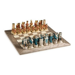 Cleopatra the Queen of the Nile Chess Set - The mystery and opulence of ancient Egypt characterize the Cambor Games Cleopatra the Queen of the Nile Chess Set. Intricately carved figurines made of Oxo-Teak were hand crafted and painted for stunning color and beauty. Pair this set with your choice of three boards. The Exotic Italian Board features inlaid 2-inch elm and root wood squares with a unique finish for years of durable beauty. Spanish artisans crafted the gray and white Swirling Stream Board with 2-inch squares from maple and erable a wood with a unique grain that lends this board a deep flowing appeal. The Traditional American board is all ready for your next tournament with a highly polished surface made of 2-inch maple and walnut wood squares.About Cambor GamesNew Jersey-based Cambor Games has spent the last 30 years developing product lines to address a variety of classic gaming needs. The company offers chess sets backgammon boards poker equipment dominoes mahjong tiles and more. From traditional designs to novelty themed items value-priced beginner sets to high-end collectors' dreams Cambor Games has the game equipment you need to have years of fun with close friends or bitter rivals.