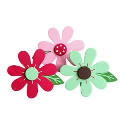 "Little Elephant Company - Samantha Brights Daisy Quilt Clips set of 3 - Beautiful quilt clips that transform your treasured baby quilts and comforters into charming hanging artwork for your child's room.    Very easy to use.  ***    This listing is a set of  three (3) daisy quilt clips. The 7 petal daisies are magenta, light pink, and light green, with accents in white, light green, magenta and iron oxide brown. The leaves are leaf green with light green accents.    These quilt clips are perfect for flower and garden themed bedding sets.    Each daisy measures 3.75 in. x 4.75 in.    How many quilt clips do I need?  - For a quilt that is still stiff and new, you will only need 2 quilt clips for up to 36 inches wide. Many people will do 3 quilt clips just for the look, though. For a quilt that has been washed and is pliable, 2 clips will be sufficient for up to 36 inches, but you may want 3 clips to help keep the center from sagging. For a quilt 36 to 42 inches wide, use 3 to 4 clips. For a quilt 42 to 50 inches, use 4 to 5 clips.    How do the quilt clips work?  - The only hardware is needed is a long nail, approximately 1 1/2"" to 2 1/2"" in length.  - Measure how far apart you would like the clips to be.  - Decide how high on the wall they will be placed and mark your first spot. Using a level, measure out and mark the second spot.  - Place your nails into the wall at a 45 degree angle. IMPORTANT: If your nail is not at a 45 degree angle, the clip may slip off the nail.  - Clip the quilt and slide the back of the clip over the nail.    What are the clips made of?  - Designs are made of layered wood. A few of our designs also have layered felt.   - Clips on the back are a sturdy plastic so as not to damage your fabric."