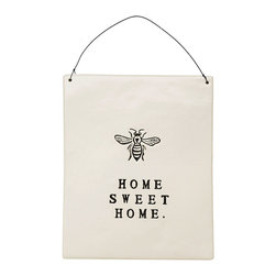 """Home Sweet Home"" Wall Plaque - Illustrated with a detailed, elegant Napoleon bee, the ""Home Sweet Home"" Wall Plaque updates a traditional element of entryway or living-room decor with a simple wire hanger and a stark, spacious design. In basic black and white with its message in classic stamped capitals, the plaque exhibits a purity of design that bespeaks assured elegance."
