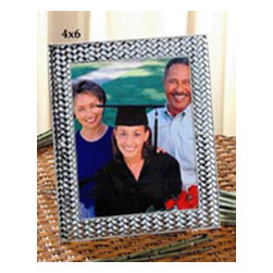 Godinger Silver - 4x6 Weave Picture Frame - Nice memories deserve an even nicer presentation. Place any photo inside and this frame is certain to complement it. Its classy yet touch of elegance makes it an all time favorite. Display it on your chest centerpiece or table accent and it will only bring you warm compliments. Dimensions: 5x7 inches.