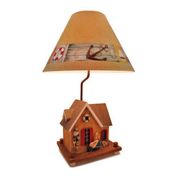 Nautical Crab Shack Beach House Table Lamp 25 In. - Aaaahhhh... It`s time to relax! Pull up your favorite easy chair and listen to the sounds of the waves crashing in the distance. Yes, this is the life and you`ve worked hard to earn it. This table lamp is the perfect getaway from the real life and a nice way to envision your happy place near the water. This durable polyresin lamp looks like the crab shack beach house we all look forward to retiring in and makes for a great decorative piece in any room in your home. It stands 25 inches tall and measures 16 inches in diameter at the base of the lamp shade, and it uses a 75 watt (max) type A standard bulb (not included). The lamp shade is perfectly decorated with all things of the sea to complement the style and feel of this lamp and your decorative tastes! This lamp is a perfect gift idea for those who love anything nautical.