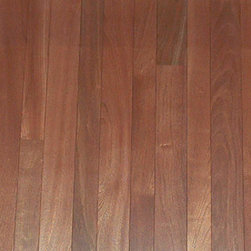 Exotic Wood Flooring - Wood can vary in color from a lighter orange-brown, to a darker reddish brown, which tends to become darker with age. The grain patterns are usually bland and undefined, though the wood has a certain depth of luster that is hard to define. There are sometimes contrasting darker grayish brown streaks or curly figures found in certain boards.
