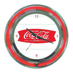 Trademark Global - Coca-Cola Refreshing Feeling Neon Clock - This retro Neon clock comes with 2 Neon rings and a UL listed AC adapter. A bright White Neon on the inside to light up the Coca-Cola graphic and a vibrant Red ring on the outside. The high gloss, Chrome molded clock case adds to the brilliant shine of the Neon. High grade glass cover and accurate quartz clock movement. Requires 2 AA batteries. 14 in. Dia. x 3 in. H (7 lbs.)
