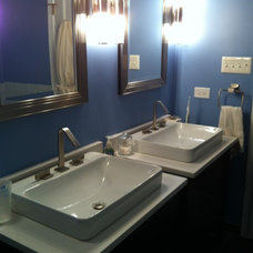 Vessel sinks and faucets by Kohler.