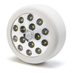 """SLM series Motion-Sensor Stick-Up Lamp - Portable and/or Fixed Round Light with White LEDs. Available with 6 or 15 LEDs in Cool or Warm White color temperature. Constant on mode or Motion-sensor mode can be used in dark areas. Hang lamp by using either back plate hook, screw holes, or double sided adhesive (not included). Measures 3-1/4"""" x 1-3/8"""". Uses 3 AA batteries not included."""
