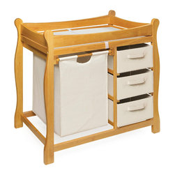 Badger Basket - Honey Sleigh Style Changing Table With Hamper/3 Baskets - This changing table keeps everything tidy and concealed for a clean look in the nursery. Large pull out hamper for dirty duds, or for storing bulk packs of diapers, blankets, and toys. And three pull-out baskets are ideal for changing supplies, clothes, socks, shoes, and toiletries. Hamper bag measures approximately 15x15x23 inches and baskets measure approximately 13x17x7 inches. It can be used with children weighing up to 30 lbs. (13.6 kg).
