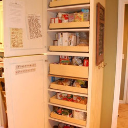 Pull Out Pantry Shelves - Floor to ceiling pull out shelves create an organized pantry where everything is easy to see and reach.  Full-extension shelves reveal all of a shelf's contents.