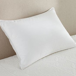 Luxury Goose-Down Pillow, Standard - Rest your head in the lap of luxury. Our supremely soft cotton pillow is filled with European white goose down for exceptional loft and comfort. Made of pure cotton. 400-thread count. Filled with white goose down. 700-fill power. Includes pillow protector, which helps lengthen the life and preserve the integrity of the pillow. Machine wash. Made in the America of imported materials.