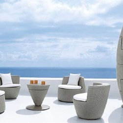 """Miami Stackable Bistro Set - As shown in the photo, this bistro set easily stacks into a """"cacoon"""" shape for convenience, style and easy storage."""