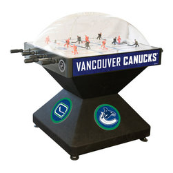 Holland Bar Stool - Holland Bar Stool DHVanCan Vancouver Canucks Dome Hockey - DHVanCan Vancouver Canucks Dome Hockey belongs to NHL Collection by Holland Bar Stool Holland Bar Stool's Officially Licensed Dome Hockey game provides hours of entertainment for the hockey fan of any level. Game is badged with your favorite team's logo on the base, sides, and at center ice. Our high-performance rod assembly underneath the surface transfers your twisting motion with a 2:1 ratio onto your players for the most responsive game play, and the clutch system prevents damage to the players when battling the opposition. TPR octagonal, sure-grip handles are attached to high-tensile steel rods that are ground and plated, maneuvering ABS players who are steel re-enforced to provide you with a long lasting game. Side mounted scoring unit provides a variety of game modes, Base includes adjustable levelers. When completing your game room, show your team pride with a Dome Hockey table from the Holland Bar Stool Company. Dome Hockey (1)