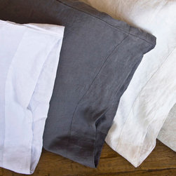 Pom Pom at Home Louwie - Slate - King Pillowcase - The clean, fresh simplicity of a slate colored pillowcase meets the ecological responsibility and visual pleasure of exquisite white linen woven from all-organic flax.  An upscale matte finish comes from the natural properties the linen fiber, valued since the Middle Ages for adorning luxurious houses and appointing bedchambers in style and comfort.  To give a balancing crispness to the effect, stitched vertical flanges slightly streamline the look of your bed.