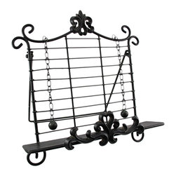 Zeckos - Wrought Iron Fleur De Lis Cookbook Holder Easel Stand - This beautiful wrought iron Fleur de Lis cookbook holder is perfect for anyone who likes to cook from recipes in cookbooks or magazines. The bottom ridge keeps you on the correct page, and weighted balls hold it in place, so you can have windows open or fans turned on. The holder measures 14 inches tall, including the cast iron Fleur de Lis finial, and is 13 inches wide. It has an attached easel leg to keep the holder upright. It makes a great housewarming gift.