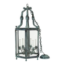 """Used Large Glass and Brass Lantern - Lanterns create a welcoming environment whether they are outside or inside a home, and this one can do it in spades!     We can imagine this grand brass lantern with its beautiful patina, hanging over the front doorway on the porch of an antebellum mansion in the South or an English manor house in the Cotswolds! This is also perfect for hanging above your dining table—indoors or out (as long as it's covered)!    This lantern has a hanging chandelier interior with six candelabra. The glass panels are all beveled. Comes with a 34""""-long chain ready for hanging. There is a very small chip in the bottom corner of one of the glass panels. the chip measures 1.5"""" x 0.5"""" and is barely visible. See photograph."""