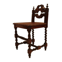 "Spindle Leg Accent Chair - Well this gal is super interesting!  We could see her fitting in perfectly with a boho, ""Montecito style"" look.  Bring on the block prints and John Robshaw! Hand-carved oak chair with spindle legs and floral details.  Attributed to Portugal. Semi-gloss finish over walnut stain. Caned seat in perfect condition.  Seat Height is 18""H."