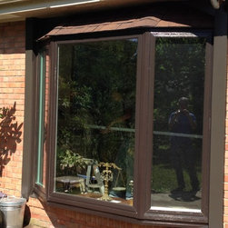 Bay Window Installation - John Hanrahan. Installed high quality Bay Window with Bronze Exterior and Wood Grained laminate interior. Built Roof over window.
