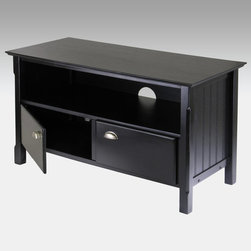 Winsome - Timber TV Stand Multicolor - 20244 - Shop for Visual Centers and Stands from Hayneedle.com! One part country charm one part modern marvel the Timber TV Stand looks great no matter what's on TV. Constructed of hardwood solids and composites covered with laminate this TV stand is finished in an oh-so-modern black while the brushed aluminum handles and carved legs add some down-home appeal. An open compartment with a wire management hole gives you space for your DVD player and gaming console while the two-door cupboard below makes it easy to stash all those DVD's. The Thomas can accommodate sets up to 44.5 inches wide and assembly with the included hardware and tools is quicker than the nightly news broadcast. About Winsome TradingWinsome Trading has been a manufacturer and distributor of quality products for the home for over 30 years. Specializing in furniture crafted of solid wood Winsome also crafts unique furniture using wrought iron aluminum steel marble and glass. Winsome's home office is located in Woodinville Washington. The company has its own product design and development team offering continuous innovation.