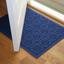 Bungalow Flooring - 24 in. L x 36 in. W Navy Waterguard Star QuiLight Mat - Made to order. Quilted star design traps dirt, resists fading, rot and mildew. Indoor and outdoor use. 24 in. L x 36 in. W x 0.5 in. H