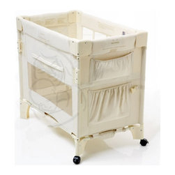"""Arm's Reach - Mini Co-Sleeper - The Co-Sleeper bassinet is a unique creation that allows you and your baby or babies to sleep safely and comfortably next to each other from the moment your infant comes home. The Co-Sleeper enables you to reach over and draw your child close for feeding without disturbing the warmth and security of you or your baby's bed. It attaches to your bed under the mattress and is securely strapped into place. It connects to twin, full, queen, king and California King adult beds. The Mini Co-Sleeper is perfect for travel and moves easily between rooms. Other available accessories include an extra fitted sheet, leg extensions, canopy and canopy cover. Conversion Instructions: -The Co-Sleeper bassinet - with one side down, the Co-Sleeper can easily be attached to the bed to allow easy access to your baby while keeping your child safe.. -The changing table - the Co-Sleeper conveniently be used as a change table by simply detaching it from the bed and can be used free-standing throughout your house.. Features: -This Co-Sleeper is not intended for use as a standard crib. -Mini collection. -Natural color. -Leg extensions available. -Lightweight frame. -Attaches with easy to use security strap under the mattress. -Converts to free-standing bassinet, changer or toy box. -Washable 100% cotton fabric liner. -Four pockets for storage. -Wheels on one end provide easier movement. -Foldable. -Metal frame with plastic components. -Accommodates beds 22"""" to 24"""" high. Dimensions: -31"""" H x 34"""" W x 20"""" D, 24 lbs."""