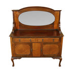 Antiques - Antique Mahogany Queen Anne Mirrorback Sideboard Server Buffet - This beautiful antique mahogany sideboard has a large bevelled edge oval mirror in the splashback which is supported by fluted brackets on either side. The sides of the piece are paneled as are the cabinet doors. There is a gorgeous crossbanding on the drawer facings, the cabinet doors, and between the cabinet doors. Although not the original, there is a key present that works well in both cabinet door locks. The drawers and cabinet doors have ornate brass drop pulls. The smooth operating drawers have dovetail joinery which is indicative of quality craftsmanship. Standing proudly on cabriole legs with scalloped brackets and pad feet, this very pretty sideboard will be a welcome addition to your home!Condition: There are moderate indentations on the right front side and a slight separation on the right side however these minor imperfections are hardly noticeable and may be considered normal wear for a piece of this age (circa 1920). Overall this piece is in very nice condition. Other Dimensions:  (In inches). Surface  36.25H x 52.5W x 18D2. Drawers  3.75H x 19.5W x 13.5D. Top Shelf  8.75H x 50.5W x 15D. Bottom Shelf  8H x 49.5W x 15.75D.