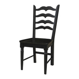 Powell - Powell Seville Side Chair in Black and Brown (Set of 2) - The Seville side chair has a classic design and timeless style. Featuring a two tone finish, the chair has a warm brown wood seat and dark black legs. The chair has an eye-catching, shapely slat back. The perfect accent to the Seville dining table.