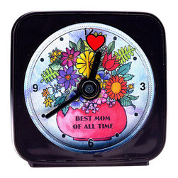 "Best Mom Alarm Clock - Our Best Mom alarm clock is a great gift for Mom's birthday, Christmas, or Mother's Day. The clock is 2'' square with a round face and the second hand is a small heart which appears to float magically around the vase of brightly colored flowers. The vase reads ""Best Mom of All Time"". Each alarm clock comes in a gift box and includes a free battery. Made in the USA. (Be sure to look for our Best Mom wall clock, too!)"