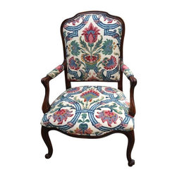Pre-owned Large French Style Armchair with Floral Upholstery - This beautiful large French style walnut armchair has been reupholstered with an elegant floral fabric. The frame is solidly constructed. This chair is a great accent piece for traditional or modern interior.