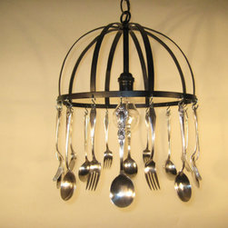 Silverware Chandelier - This unique chandelier is made using antique silver plated spoons and forks that are hanging from a simple black metal frame. 8 salad forks and 8 soup spoons were used to make this whimsical pendant light fixture. Use your good silver every day! This light will make a beautiful addition to any kitchen or dining room.