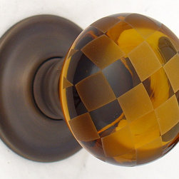 Amber glass door knobs - Handmade solid glass door knobs available in a ranage of colours and finish options.  Merlin Glass the ultimate in luxury glass knobs.