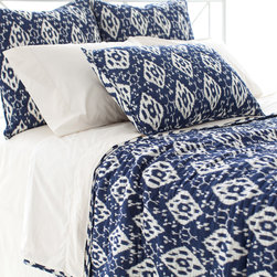 """Pine Cone Hill - PCH Varkala Indigo Quilt - The PCH Varkala quilt's eclectic style expresses bold, worldly panache. This lightweight blanket delivers modern sophistication with a reversible indigo and white floral pattern. 100% cotton; Machine wash; Available in twin, full/queen and king sizes; Designed by Pine Cone Hill, an Annie Selke company Twin: 68""""W x 88""""H; Full/queen: 88""""W x 88""""H; King: 102""""W x 92""""H"""