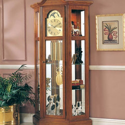 "Ridgeway Clocks - Oak Lawn Finished Ridgeway Curio Clock with S - Upper lighting breathes new life into the higher shelves of this beautiful curio clock, which features many shelves of storage space to show off your belongings in style. The clock face is finished in a polished brass color, and shines along with the pendulum and weights beneath it. * This canted end curio clock with softly arched bonnet features glassaccess panels, allowing full view of the clock's movement.. The lighted top section has two glass shelves as well as two adjustableshelves in the pendulum area.. A mirrored back case adds sparkle to anydisplay.. Oak Lawn finish on select hardwoods and oak veneers compliment apolished brass finished dial with black Roman numerals and stationaryastrological moon dial.. A harp pendulum with 6 1/2"" (165mm) polished brass disk and polishedbrass weight shells, bring this chain driven movement with Westminsterchime to life.. The front door comes with a lock for added security.. 77 H x41 W x 11 D"