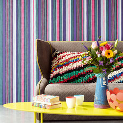 Raval - An ultra modern living space filled with bright colors, mod couch and a posh striped wallpaper.