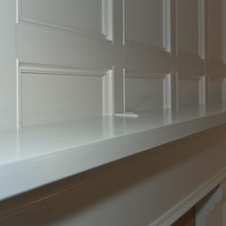 Mantle top detail - Mantle with board and batten wall. an electrical outlet was added for accent lights or ...