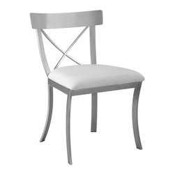 """Sunpan Modern - Status Side Chair - Features: -Material: Faux leather. -Chrome finished stainless steel. -Popular Maiden dining chair with cross stretchers on the back. -Seat height: 18.5"""". -Please note that although every attempt has been made to ensure accuracy, all dimensions are approximate and colors may vary. -Please note that the leg color on Sunpan dining chairs does not always match the dining table color. -This item is deemed acceptable for both residential and nonresidential environments such as restaurants, hotels, lounges, offices and reception areas. Please note that this item carries the manufacturer's standard ONE YEAR WARRANTY from the date of purchase. Please contact Wayfair customer service or sales representatives for further information."""