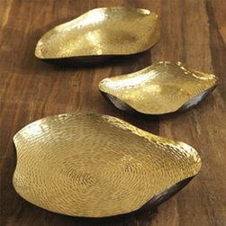 Set of Three Brass Alchemy Trays - I love mixing metals. Silvers and chromes make a room sparkle while gold adds warmth. The beautiful texture of these pieces reminds me of tree rings. I especially love how they are not only works of art on their own, but also functional pieces as well.