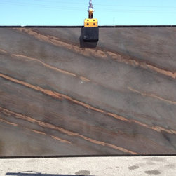 Royal Stone & Tile Showroom - Elegant Brown quartz granite slabs in stock at Royal Stone & Tile in Los Angeles.  Beautiful exotic stone which can be used for kitchen countertop applications.