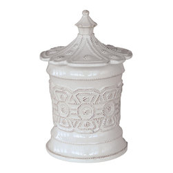 Jardins Du Monde Heligan Canister - Small - Whitewash - A scalloped lid and a handsome Sun King-inspired pattern worked into not-quite-cylindrical walls give courtly grace to the high-style Heligan Canister.  Made from chip-resistant, durable stoneware and glazed in a snow-marble Whitewash, this lasting canister is both useful and aesthetically pleasing in the traditional home, where its upscale formality continues a theme of bygone elegance.