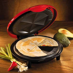 Nostalgia Products - 8 in. Electric Quesadilla Maker - Stands on edge for storage. Power light and ready light. Locking lid with 2 positions. Unique plate design with pockets create sectional pieces. Non stick coating. Wattage: 900 W. Cooking time: 3-7 mins. Removable drip tray. Warranty: 90 days. 8 in. Dia.The 8-Inch Electric Quesadilla Maker creates a uniquely fun food experience. Delight in quickly creating crispy, delicious quesadillas using a variety of meats, cheeses and vegetables - even peanut butter or Nutella for sweet varieties. The unique plate design creates easy-to-cut sections that seal in flavorful ingredients, making each slice perfect. The non-stick coating makes cooking easy and clean-up a snap. The unit design allows the product to stand on end, making storage simple.