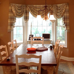 Custom-Made Work - This custom made valance on the kitchen window dresses up the room very nicely! Choose from hundreds of different fabrics and styles to best compliment your home décor.