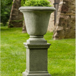 Campania International - Campania International Rustic Hampton Urn Planter with Pedestal - PPD-554-AL - Shop for Planters and Pottery from Hayneedle.com! The handsome Campania International Rustic Hampton Urn Planter with Pedestal elevates your landscape design. Perfect for contemporary or classic outdoor settings this set includes an unadorned urn planter with rustic texture and a stately pedestal base. Both are made of cast stone using a 15-step process that will withstand the elements in style. Available in a variety of aged finish options. Campania Cast Stone: The ProcessThe creation of Campania's cast stone pieces begins and ends by hand. From the creation of an original design making of a mold pouring the cast stone application of the patina to the final packing of an order the process is both technical and artistic. As many as 30 pairs of hands are involved in the creation of each Campania piece in a labor intensive 15 step process.The process begins either with the creation of an original copyrighted design by Campania's artisans or an antique original. Antique originals will often require some restoration work which is also done in-house by expert craftsmen. Campania's mold making department will then begin a multi-step process to create a production mold which will properly replicate the detail and texture of the original piece. Depending on its size and complexity a mold can take as long as three months to complete. Campania creates in excess of 700 molds per year.After a mold is completed it is moved to the production area where a team individually hand pours the liquid cast stone mixture into the mold and employs special techniques to remove air bubbles. Campania carefully monitors the PSI of every piece. PSI (pounds per square inch) measures the strength of every piece to ensure durability. The PSI of Campania pieces is currently engineered at approximately 7500 for optimum strength. Each piece is air-dried and then de-molded by hand. After an internal quality check pieces are sent to a finishing department where seams are ground and any air holes caused by the pouring process are filled and smoothed. Pieces are then placed on a pallet for stocking in the warehouse.All Campania pieces are produced and stocked in natural cast stone. When a customer's order is placed pieces are pulled and unless a piece is requested in natural cast stone it is finished in a unique patinas. All patinas are applied by hand in a multi-step process; some patinas require three separate color applications. A finisher's skill in applying the patina and wiping away any excess to highlight detail requires not only technical skill but also true artistic sensibility. Every Campania piece becomes a unique and original work of garden art as a result.After the patina is dry the piece is then quality inspected. All pieces of a customer's order are batched and checked for completeness. A two-person packing team will then pack the order by hand into gaylord boxes on pallets. The packing material used is excelsior a natural wood product that has no chemical additives and may be recycled as display material repacking customer orders mulch or even bedding for animals. This exhaustive process ensures that Campania will remain a popular and beloved choice when it comes to garden decor.About Campania InternationalEstablished in 1984 Campania International's reputation has been built on quality original products and service. Originally selling terra cotta planters Campania soon began to research and develop the design and manufacture of cast stone garden planters and ornaments. Campania is also an importer and wholesaler of garden products including polyethylene terra cotta glazed pottery cast iron and fiberglass planters as well as classic garden structures fountains and cast resin statuary.
