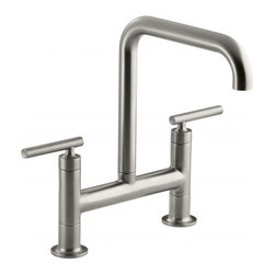 Kohler - Kohler Purist Steel Deck-mount Faucet - Pairing a classic bridge design with bold new touches,this Purist kitchen faucet from Kohler combines distinctive modern style and easy-to-use features. The high-arch spout provides 10 inches of clearance and rotates 360 degrees.