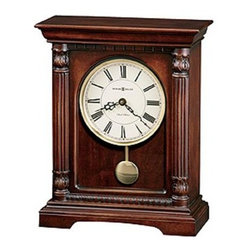 HOWARD MILLER - Howard Miller Langeland Bracket-Style Mantel Clock - This stately bracket-style mantel clock features reeded columns with carved top and bottom caps, and a decorative molding at the top and bottom of the multitiered base.