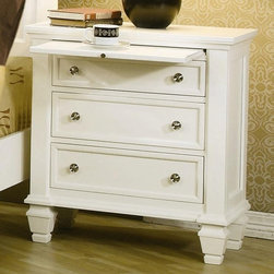 Coaster - Sandy Beach 29 in. Nightstand (White) - Finish: WhiteContemporary style. Three storage drawers. One pull out tray. Dovetail construction for durability. Fully extending drawers. Smooth top with simple classic molding edge. Clean lines and square tapered feet. Simple silver tone knobs. Made from tropical hardwoods and veneers. 29 in. W x 16 in. D x 30.5 in. H. WarrantyThis classic nightstand will be the perfect addition to your master bedroom.