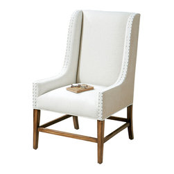 Dalma Wing Chair - A wonderful addition to your transitional home that invites an afternoon repose with a favorite book and a cup of tea, a long overdue chat with family or friends, or a quiet interlude of cozy comfort. The Dalma Wing Chair features upholsterer's tacks edging along the tan burlap sides and the soft neutral linen front. The solid hardwood frame of sun-washed pine suggests the gentle touch of time.