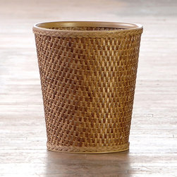 Carter Cappuccino Round Woven Wastebasket - Bathrooms are often slick and shiny. Try adding a woven wastebasket for contrasting texture and warmth. Place a smaller plastic or metal trash can inside for easy cleaning.