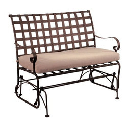 O.W. Lee Classico Wrought Iron Setee Glider - Glide gently back and forth while enjoying the cool summer evening with the O.W. Lee Classico Settee Glider. Beautifully made from handcrafted wrought iron, this settee glider features a classic basket weave design and Old World craftsmanship. A beautiful addition to your patio, porch, deck, or garden, the Settee Glider is perfect for sitting and relaxing with a close friend or loved one while you chat and enjoy the beauty of nature together. The Settee Glider comes with a Sunbrella cushion available in your choice of color so you can accent the natural colors of your backyard. Sunbrella cushions are fade-, stain-, mildew-, and water-resistant and come with a five year warranty. You'll enjoy sneaking outdoors in the early morning to enjoy your first cup of coffee alone, or spending time with your children while you watch the stars come out. Wherever you place this settee glider, it invites you to enjoy time with loved ones or relaxing and letting the stress of the day go.Please note: This piece will be delivered with White Glove service which includes location placement. Unpacking and assembling the item will be left to the customer. Due to the custom-made nature of this item, orders usually ship within approximately 5 weeks. Because each item is assembled just for you, orders cannot be cancelled. A 50% restocking fee will apply for returns.This item is custom-made to order, which means production begins immediately upon receipt of each order. Because of this, cancellations must be made via telephone to 1-800-351-5699 within 24 hours of order placement. Emails are currently not acceptable forms of cancellation. Thank you in advance for your consideration in this matter.Materials and construction:Only the highest quality materials are used in the production of O.W. Lee Company's furniture. Carbon steel, galvanized steel, and 6061 alloy aluminum is meticulously chosen for superior strength as well as rust and corrosion resistance. All materials are individually measured and precision cut to ensure a smooth, and accurate fit. Steel and aluminum pieces are bent into perfect shapes, then hand-forged with a hammer and anvil, a process unchanged since blacksmiths in the middle ages.For the optimum strength of each piece, a full-circumference weld is applied wherever metal components intersect. This type of weld works to eliminate the possibility of moisture making its way into tube interiors or in a crevasse. The full-circumference weld guards against rust and corrosion. Finally, all welds are ground and sanded to create a seamless transition from one component to another.Each frame is blasted with tiny steel particles to remove dirt and oil from the manufacturing process, which is then followed by a 5-step wash and chemical treatment, resulting in the best possible surface for the final finish. A hand-applied zinc-rich epoxy primer is used to create a protective undercoat against oxidation. This prohibits rust from spreading and helps protect the final finish. Finally, a durable polyurethane top coating is hand-applied, and oven-cured to ensure a long lasting finish.About SunbrellaSunbrella has been the leader in performance fabrics for over 45 years. Impeccable quality, sophisticated styling and best-in-class warranties prove the new generation of Sunbrella offers more possibilities than ever. Sunbrella fabrics are breathable and water-repellant. If kept dry, they will not support the growth of mildew as natural fibers will. Beautiful and durable, Sunbrella is a name you can trust in your outdoor furniture.About O.W. Lee CompanyAn American family tradition, O.W. Lee Company has been dedicated to the design and production of fine, handcrafted casual furniture for over 60 years. From their manufacturing facility in Ontario, California, the O.W. Lee artisans combine centuries-old techniques with state-of-the-art equipment to produce beautiful casual furniture. What started in 1947 as a wrought-iron gate manufacturer for the luxurious estates of Southern California has evolved, three generations later, into a well-known and reputable manufacturer in the ever-growing casual furniture industry.