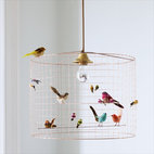 Birdcage Chandelier - Love this contemporary take on a birdcage that also functions as a chandelier.